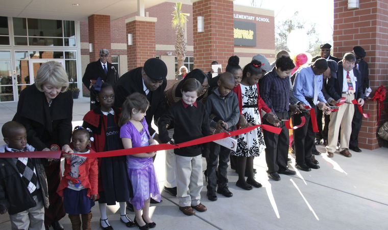 Members of the Florence School District 1 board of trustees and North Vista students open the ribbon-cutting ceremony at North Vista Elementary school in Florence Saturday morning. The new school opened in August of 2014 after over two years of contstruction at 1100 N. Irby Street.