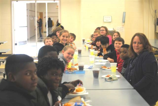 The class that collected the most money in a Johnsonville Middle School competition to buy books for children in the MUSC Children's Hospital in Charleston was treated to a pizza party. The winning class was Lacinda Burrows' and Donell Mace's sixth grade class.