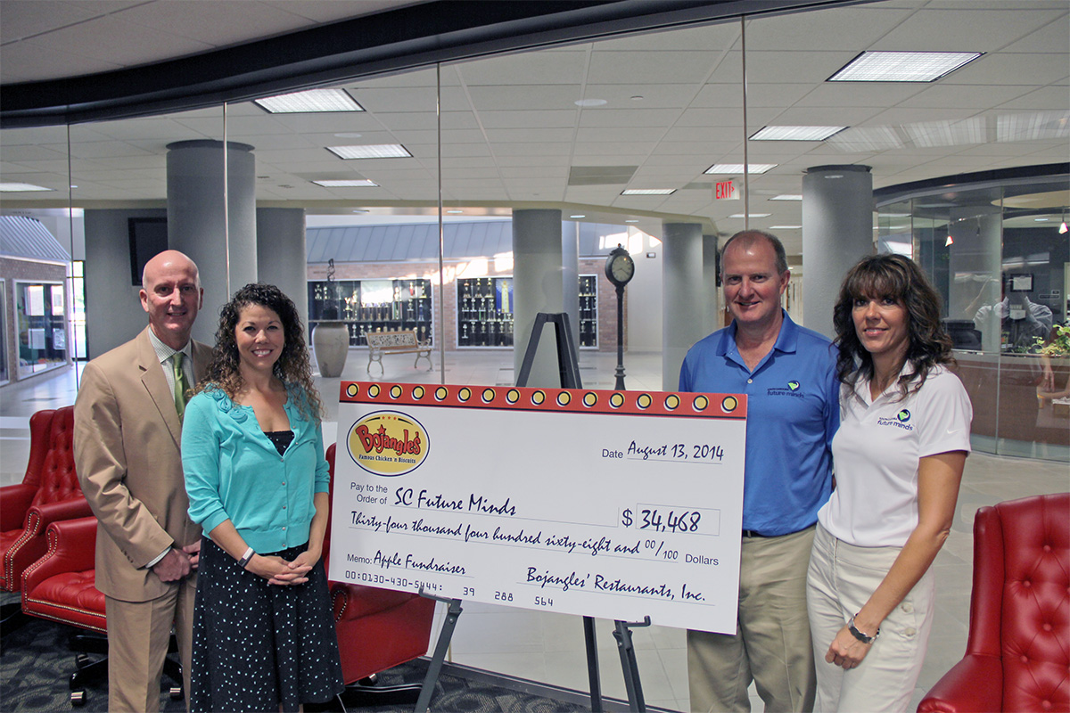 On August 13, 2014, Bojangles' presented a check to SC Future Minds for $34,000 riased during South Carolina Teacher Appreciation Month in May. Pictured from left to right: Ken Reynolds and Dorrance Bickford of Bojangles', South Carolina Future Minds Executive Director Trip DuBard and South Carolina Future Minds Administrator Debbie Jones.